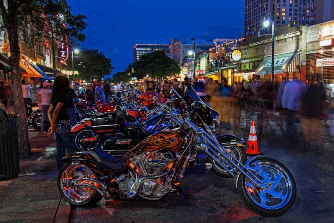 Motorcycles parked along the street for Bike Week